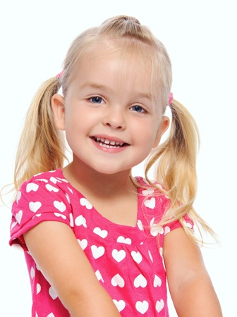 pigtails: adorable blonde girl with pigtails smiles in studio, isolated on white  Stock Photo