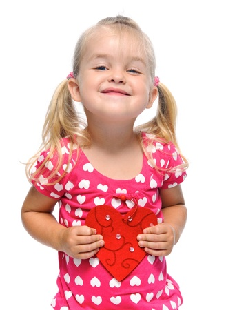 pigtails: smiling blonde girl with valentine heart is isolated in studio