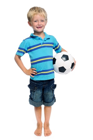 aspiring: Happy boy stands with a football, aspiring to be a professional soccer player