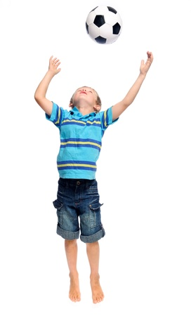 throw up: Cute boy throws and jumps with a football in studio, isolated on white