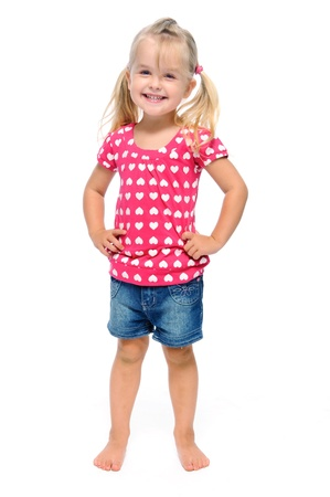 blonde little girl: young girl poses for a picture isolated on white  Stock Photo