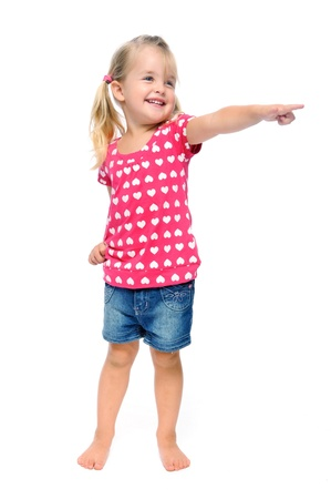 kid pointing: isolated young blonde girl points out of frame, good area for copyspac Stock Photo