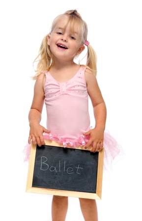 young ballerina with chalk board smiles in studio  photo
