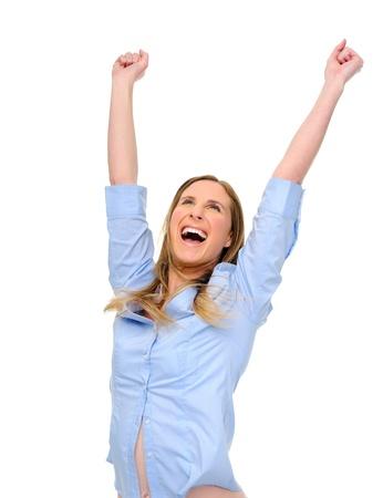 raises: Woman raises her arms overhead in joy Stock Photo