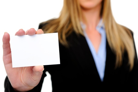 Woman in a business suit holding a blank card for your message, isolated on white photo