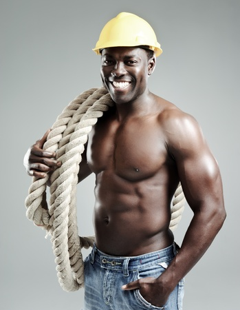 man with rope has construction helmet for protection Stock Photo - 10570484