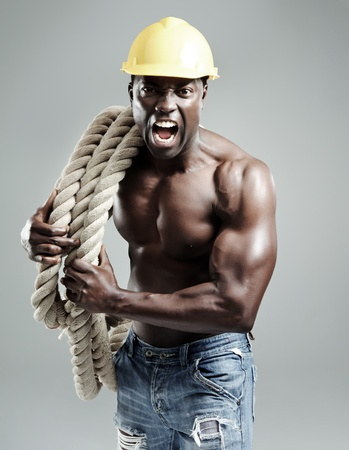 Aggresive well toned black man with rope Stock Photo - 10570450