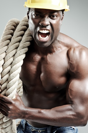 Aggresive well toned black man with rope  Stock Photo - 10570459