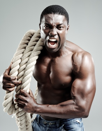 Aggresive well toned black man with rope  Stock Photo - 10570496