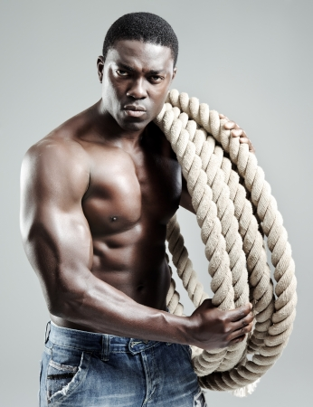 incredible ultimate man has a rope and strong musles Stock Photo - 10570497