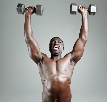 Well built muscular black man lifting weights  photo