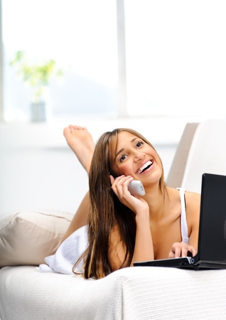 chats: Pretty girl chats happily on the phone, enjoying her leisure time  Stock Photo
