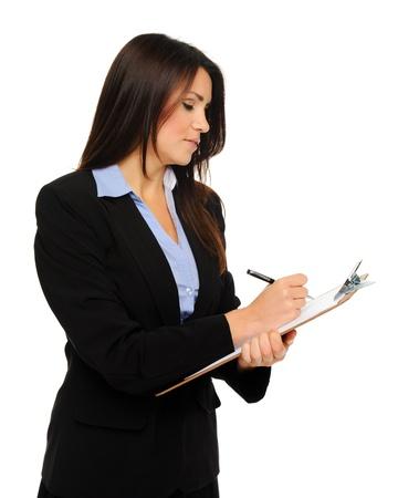 recoger: Investigador en traje formal de negocios escribe la información en el portapapeles, aislados en blanco Foto de archivo