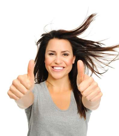 windswept: Pretty woman is jubilant with windswept hair  and thumbs up