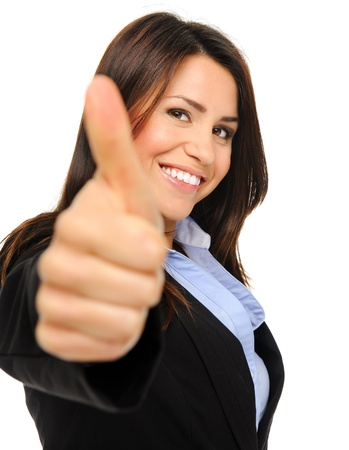 SATISFIED: Pretty brunette in formal business attire giving the thumbs up, isolated on white, focus on face
