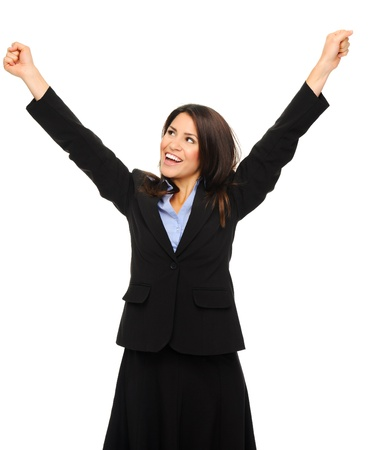 winning woman: Pretty brunette in formal business attire raises her arms up in excitement