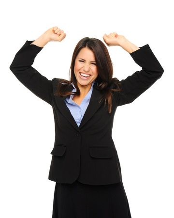 triumphant: Pretty brunette in formal business attire raises her arms up in excitement