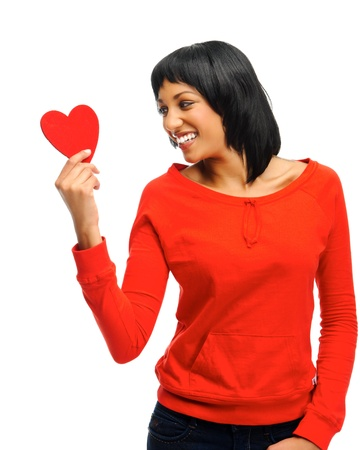cheeky: Cute indian woman holding a heart symbol, great for valentines day theme  Stock Photo