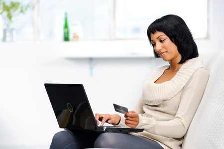 decides: Pretty girl decides carefully before making an online booking