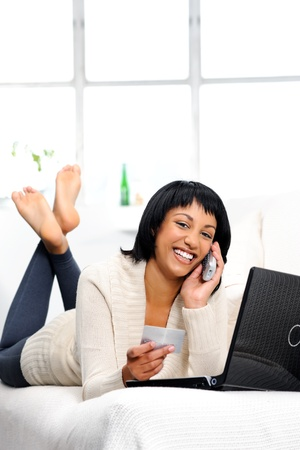 Woman is happy to be connected remotely to her bank details via phone and the internet Stock Photo - 10861506
