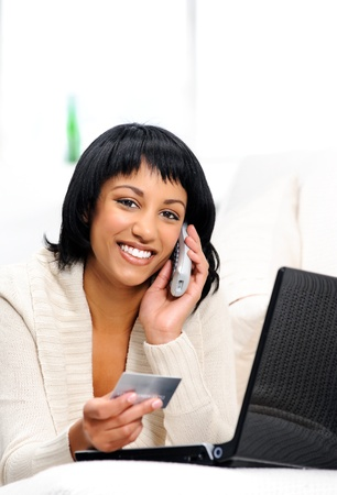 Woman is happy to be connected remotely to her bank details via phone and the internet  photo
