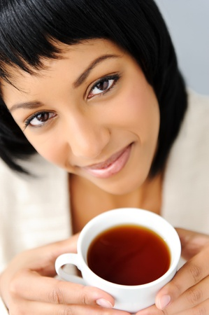 contented: Pretty girl poses with her cup of tea  Stock Photo