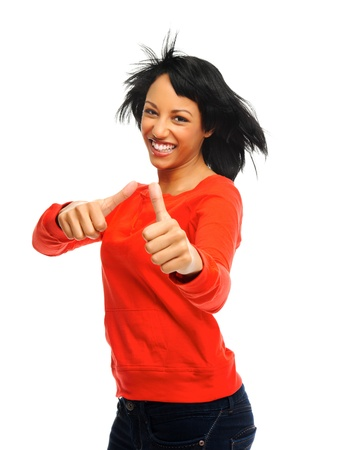 windswept: Happy attractive girl with two thumbs up and windswept hair, shot in studio isolated on white