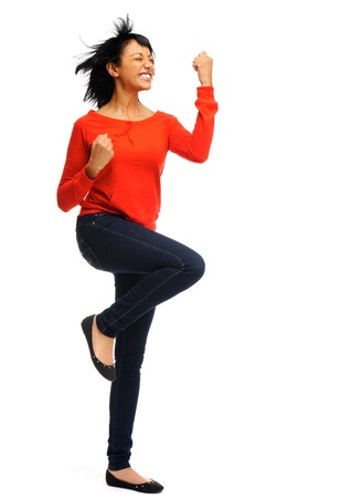 euphoric: Happy woman celebrates by cheering and dancing in studio, isolated on white