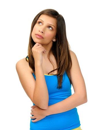 white singlet: thoughtful young woman in studio looks upward, great for copyspace