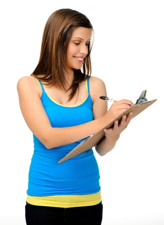 white singlet: attractive young woman writes with a clipboard. researcher, survey or student taking notes.