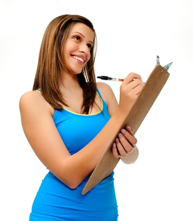 clipboard isolated: attractive young woman writes with a clipboard. researcher, survey or student taking notes.