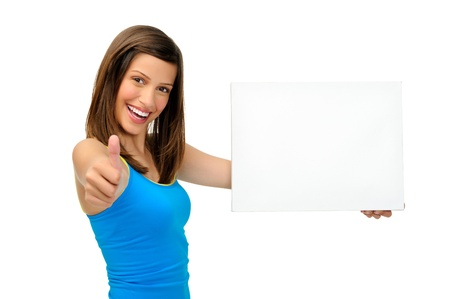 approachable: young woman holds a blank board providing copyspace for any advertising. friendly, approachable and smiling