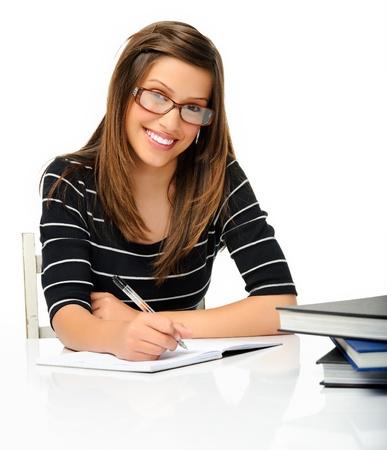 nerd girl: attractive student doing work isolated in studio