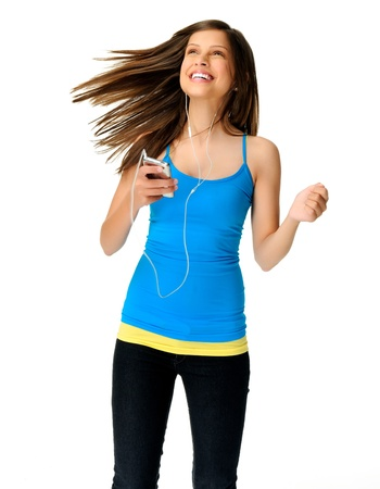 young woman dances while listening to music on her mp3 player photo