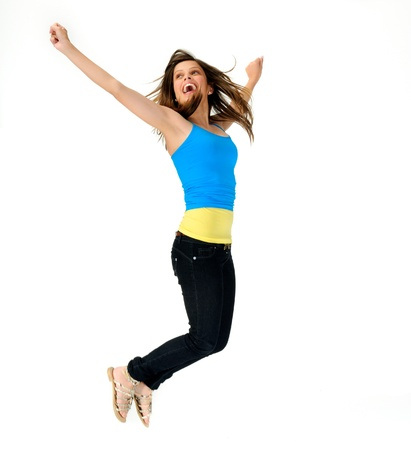 young woman jumps for joy in studio, happy and fresh photo