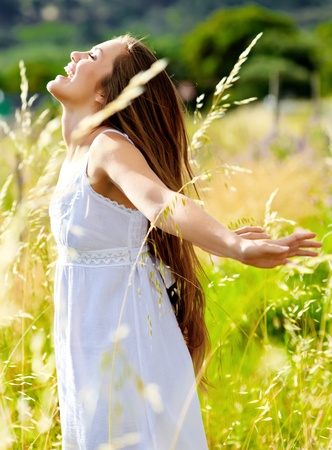 happy woman is at peace in the sunlight, carefree summer concept Stock Photo - 11474448