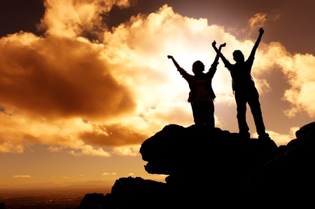 victory stand: sunset mountain climbing victory celebration Stock Photo