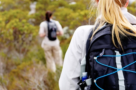 rear view of a woman trekking outdoors with a backpack Stock Photo - 11474436