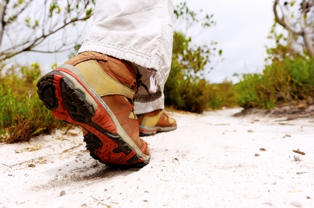 adult footprint: closeup of a hiking boot on a footpath Stock Photo