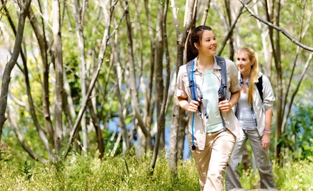 two beautiful attractive woman hiking outdoors in the woods. healthy active lifestyle concept Stock Photo - 11474428