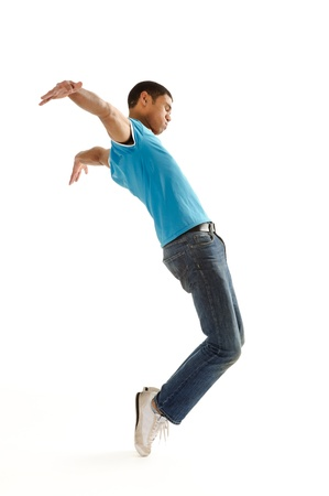 break dance: Breakdancer does expressive move and bends backwards isolated on white