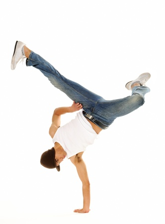 hip hop dance: Urban stylse street breakdancing handstand grab move done isolated on white in studio Stock Photo