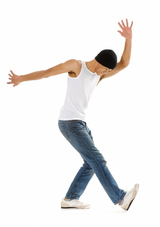 dance studio: Cool breakdancer does a common dance pose isolated on white