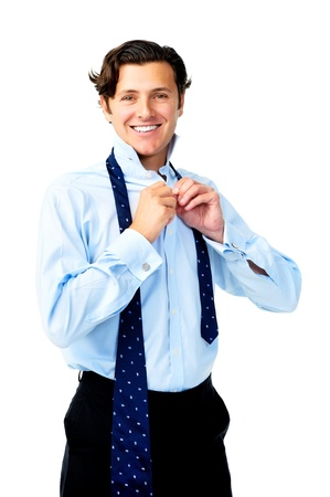 Confident caucasian man is happy while he dresses for work Stock Photo - 11598352