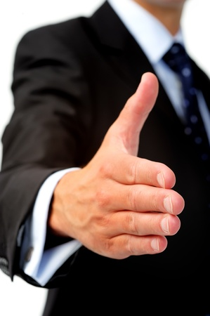 Anonymous caucasian man in business suit offers his hand as a congratulatory gesture  photo