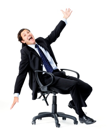 arm chair: Silly office worker wasting time and playing a fool spinning on his office chair  Stock Photo