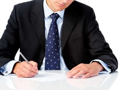 formalities: Anonymous man in formal suit signs some paperwork