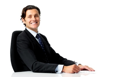 Happy businessman prepares to sign a contract Stock Photo - 11598342