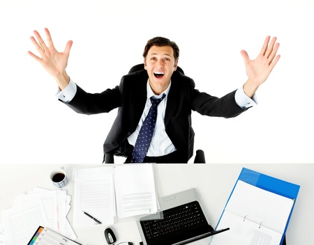 overwhelm: Businessman throws his arms up in frustration when he does paperwork