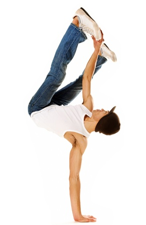 moves: breakdancer does moves while perfoming a hand stand